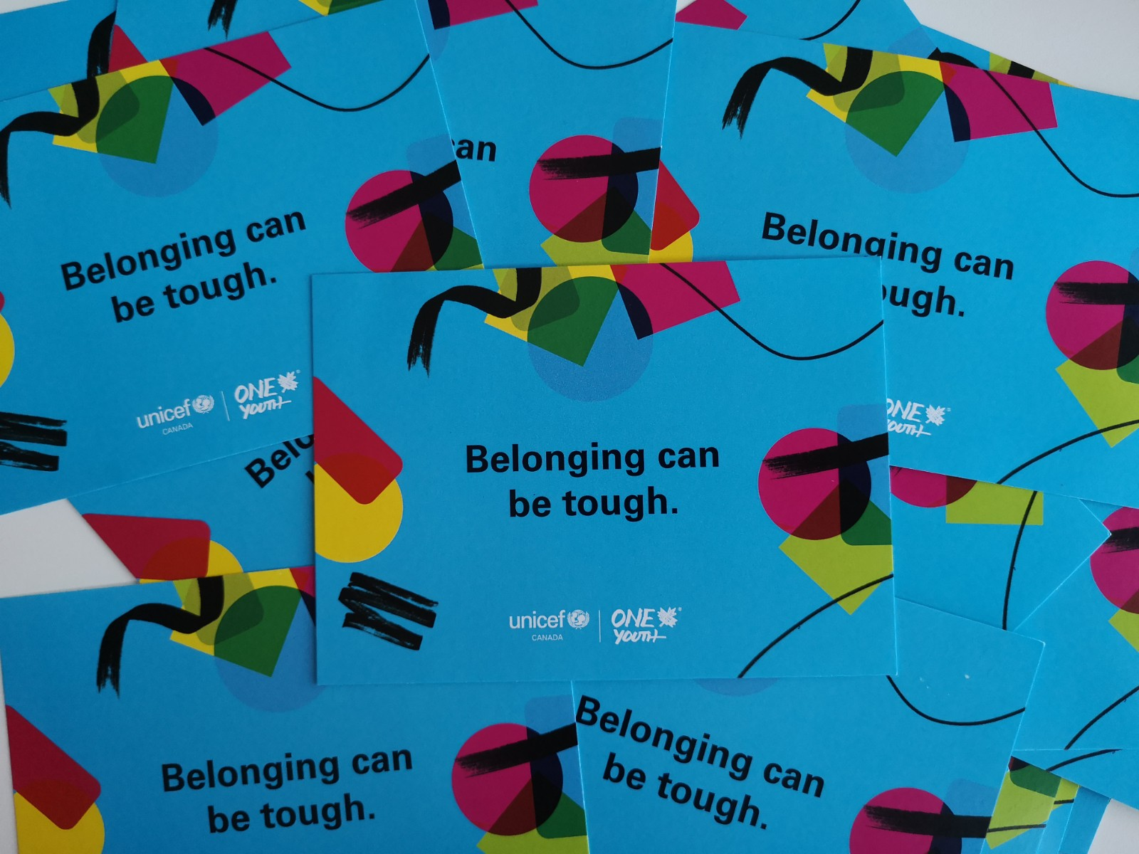 "Postcards that read ""Belonging Can Be Tough"""